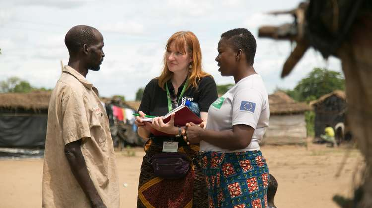 Sandra Schuckmann-Honsel in conversation with people in Malawi