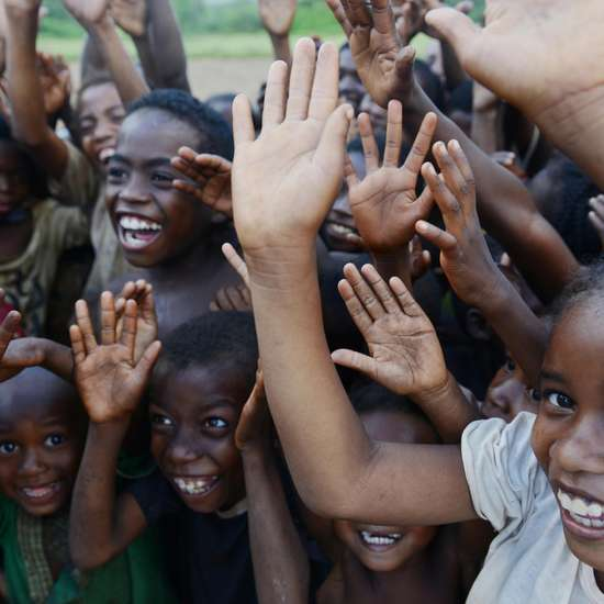 Joyful greeting of children in the project area Ravomena, Madagascar.