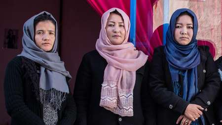 Graduates of Welthungerhilfe's vocational training programme in fron of their own business in Kabul