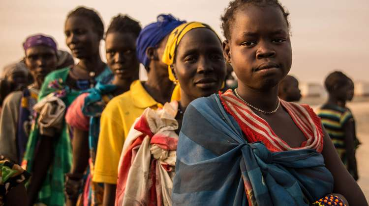 Women queuing in the early morning to receive food in the Bentiu refugee camp in South Sudan