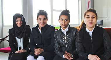 Girls talking about their new school designed and built by Welthungerhilfe in Domiz, Northern Iraq.