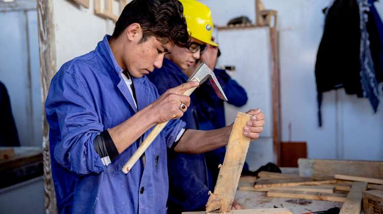 18-year-old Abdul working with wood