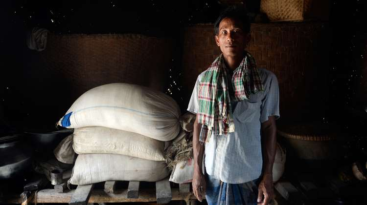 Farmer Jogndralal Dhamai in his store room