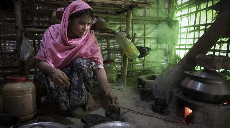 Rohingya woman Mostafa B. is cooking a meal in camp Hakimpara, Bangladesh.