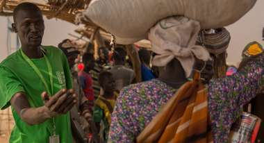 Refugees receive food items from Welthungerhilfe staff in a refugee camp in Bentiu, South Sudan.