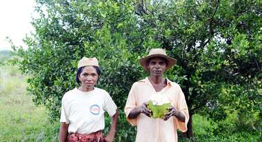 Two farmers: a woman and a man
