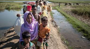 Rohingya refugees crossing the border from Myanmar to Bangladesh