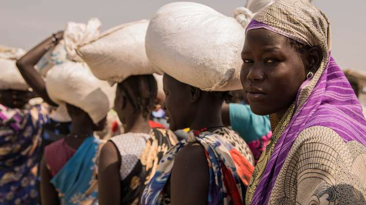 Women are waiting at a food distribution centre at the refugee camp in Bentiu, Southern Sudan.