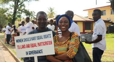 Women protesting for better land rights and equal participation in Liberia