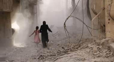 A mother and her child escape the destruction in the Syrian town of Douma in the district of Damascus (2015)