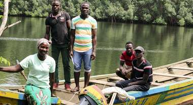 The Gbawleh family with their new boat