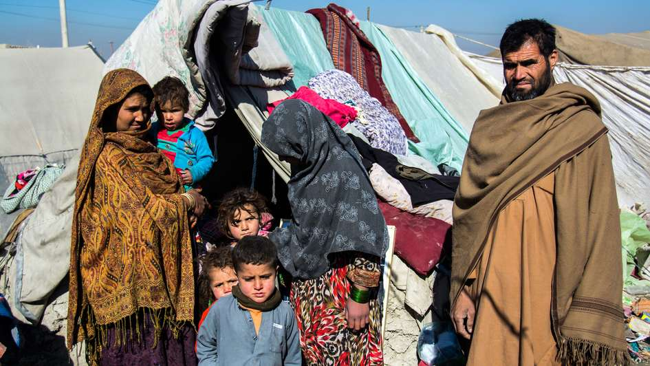 Refugee family in a camp in Kabul