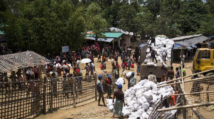 Hakimpara refugee camp in Bangladesh: Local NGO FIVDB distributes sacks with charcoal and rice husk pellets to Rohingya refugees (August 2018).